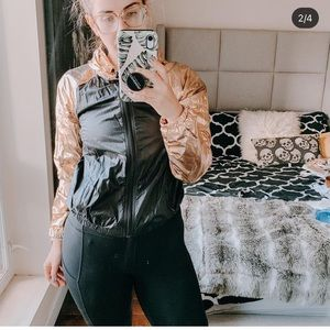 Black and gold zip up jacket from JoyLab